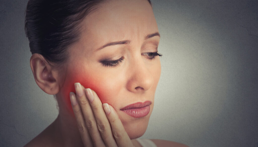 woman with sensitive tooth ache crown problem about to cry from pain